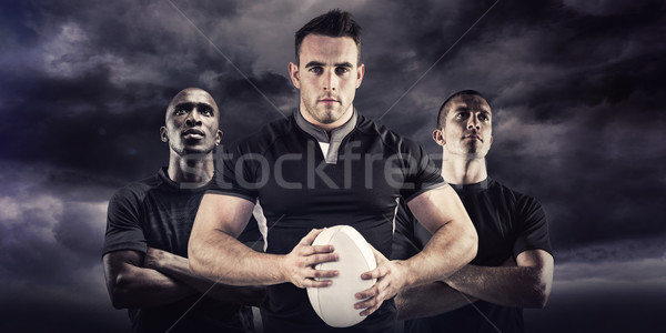 Composite image of tough rugby player looking at camera Stock photo © wavebreak_media