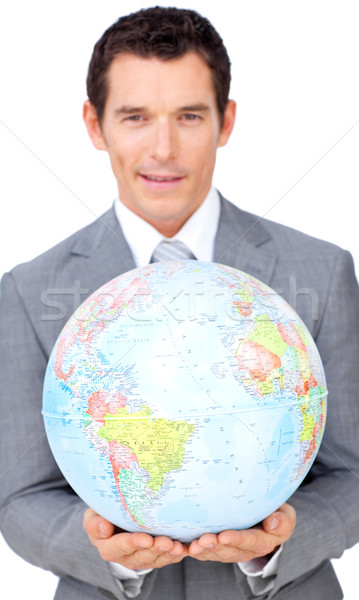 Assertive businessman holding a terrestrial globe  Stock photo © wavebreak_media
