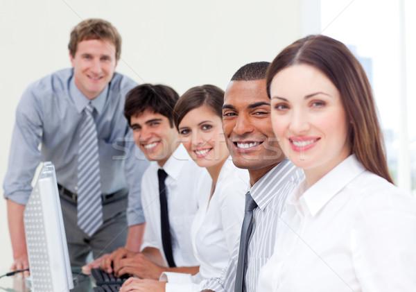 Assertive business team at work Stock photo © wavebreak_media