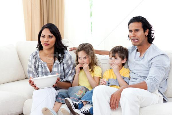 Konsantre aile izlerken tv kanepe oturma odası Stok fotoğraf © wavebreak_media