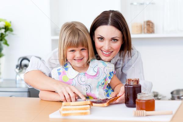Attentive mother helping her daughter prepare the breakfast Stock photo © wavebreak_media