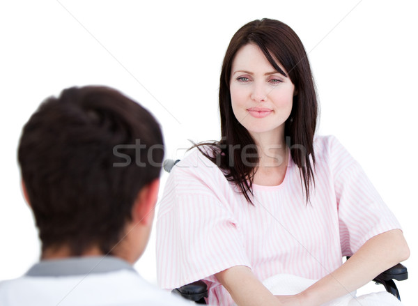 Female patient in a wheelchair interacting with her doctor  Stock photo © wavebreak_media