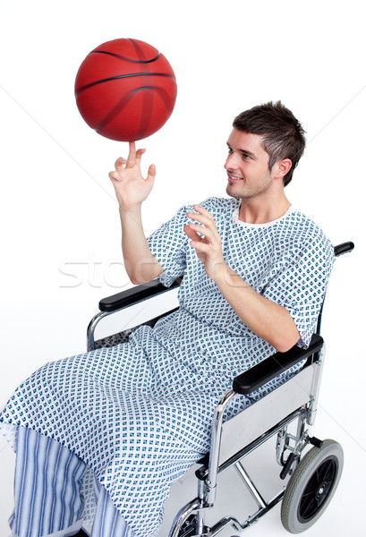 Patient in wheelchair spinning a basket ball on his finger Stock photo © wavebreak_media