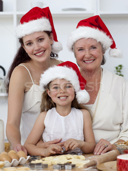 Daughter, mother and grandmother baking Christmas sweets Stock photo © wavebreak_media