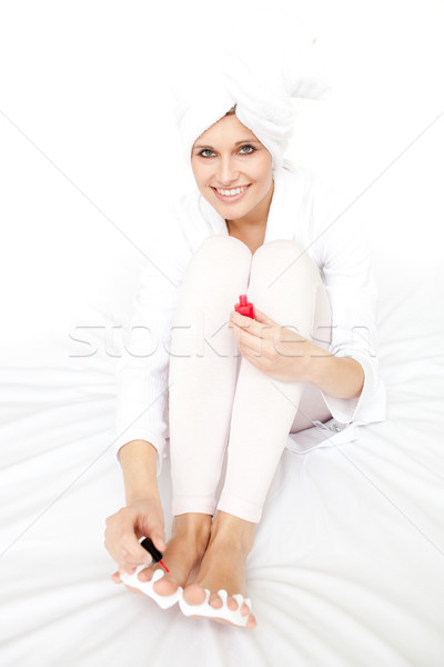 Attractive woman painting her nails  Stock photo © wavebreak_media