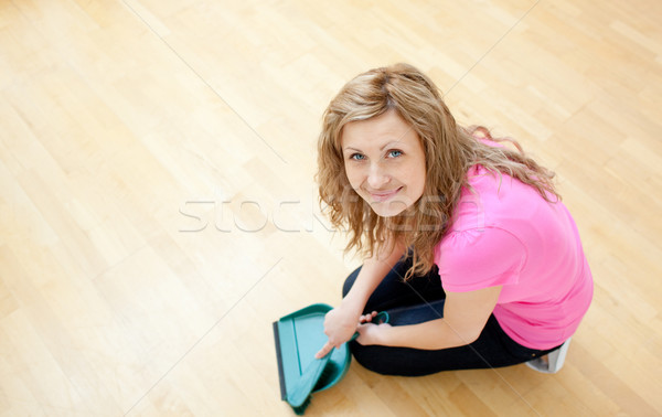 Smiling young woman cleaning the floor  Stock photo © wavebreak_media