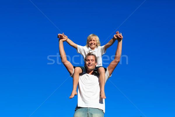 Apa fiú háton kék ég mosoly szeretet Stock fotó © wavebreak_media