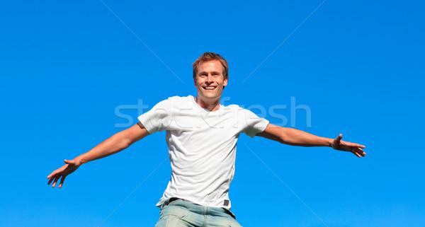 Cheerful man jumping in the air Stock photo © wavebreak_media