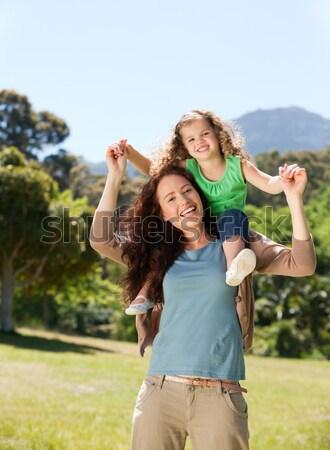 Anya lánygyermek háton fiatal nő mosoly Stock fotó © wavebreak_media