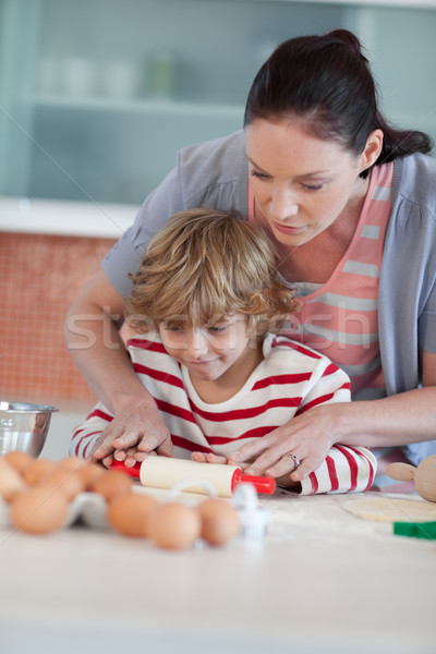 Nice mother and his son baking in a kitchen Stock photo © wavebreak_media
