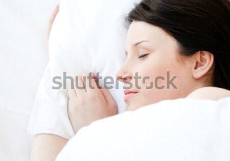 Stock fotó: Nyugodt · fiatal · nő · ágy · alszik · otthon · mosoly