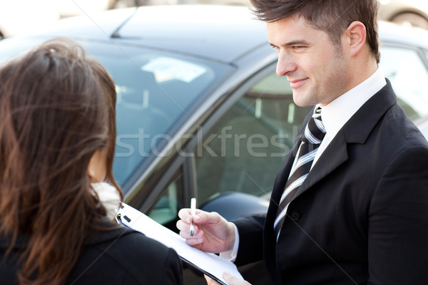Confident businessman undersign a car contract Stock photo © wavebreak_media