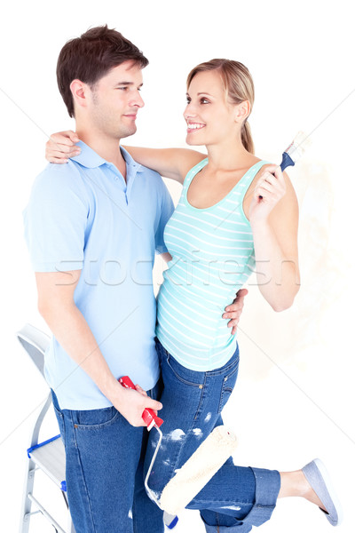 Affectionate young couple painting a room in their new house Stock photo © wavebreak_media