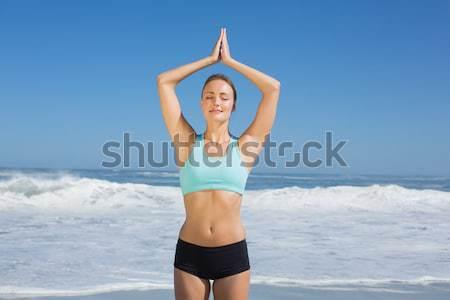 Athletic woman doing exercise over sea background  Stock photo © wavebreak_media