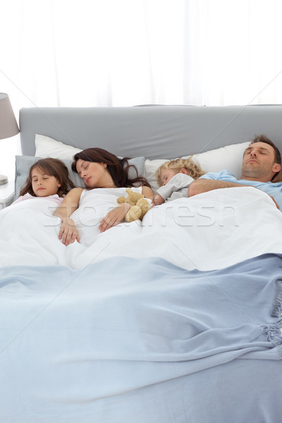 Peaceful family sleeping together in the parents's bed Stock photo © wavebreak_media