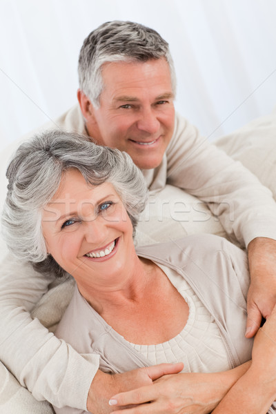 Mature couple looking at the camera at home Stock photo © wavebreak_media