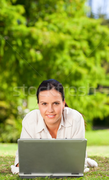 Young woman working on her laptop Stock photo © wavebreak_media