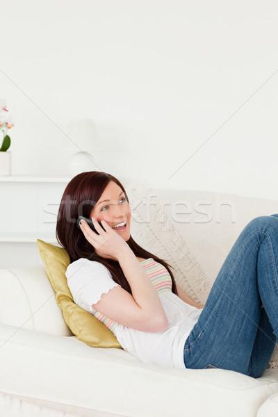 Güzel kadın konuşma telefon kanepe oturma odası Stok fotoğraf © wavebreak_media