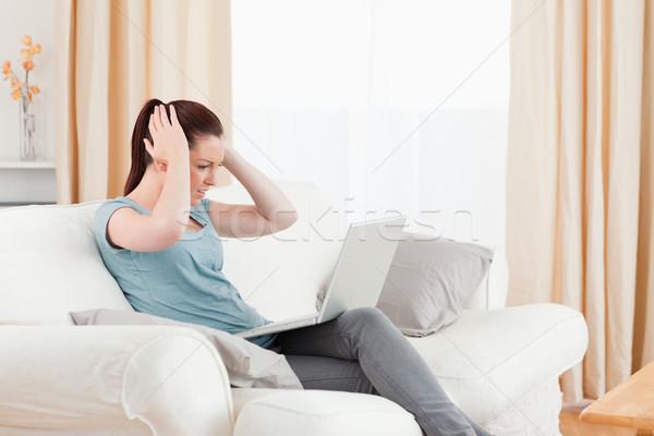 расстраивать женщину игорный компьютер сидят диван Сток-фото © wavebreak_media