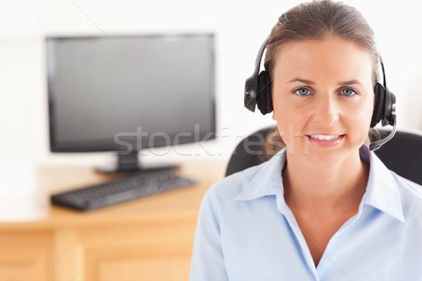 Office worker wearing a headset posing  in her office Stock photo © wavebreak_media