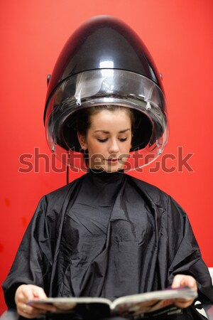 Portrait of a young woman under a hairdressing machine while looking at the camera Stock photo © wavebreak_media
