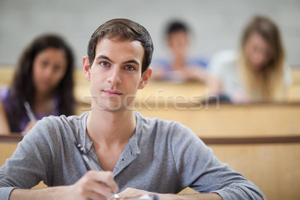 College students taking notes in an amphitheater with the camera focus on the foreground Stock photo © wavebreak_media