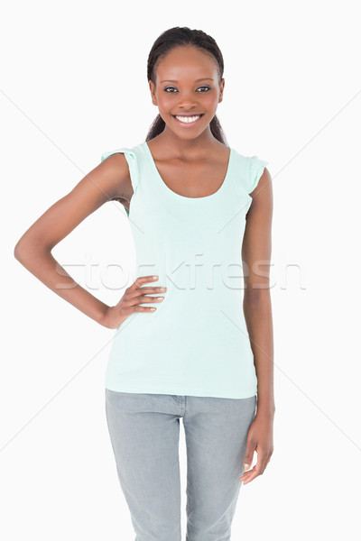 Close up of smiling young woman with one arm akimbo on white background Stock photo © wavebreak_media