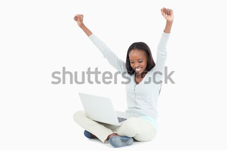 Young woman celebrating a successful online auction against a white background Stock photo © wavebreak_media