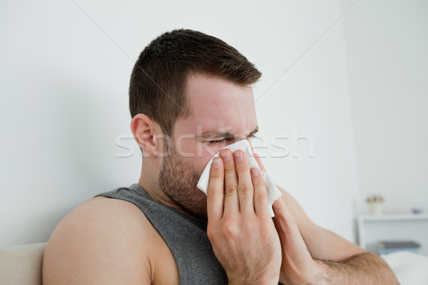 Malade homme moucher chambre main visage Photo stock © wavebreak_media