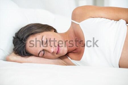 Ritratto tranquillo uomo pancia camera da letto sorriso Foto d'archivio © wavebreak_media