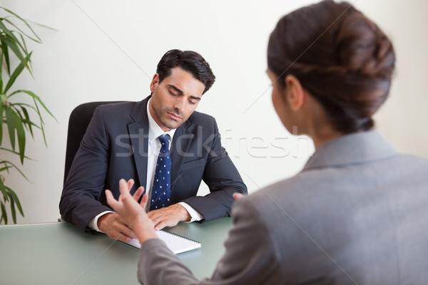 Focused marketers having a brainstorming in a meeting room Stock photo © wavebreak_media