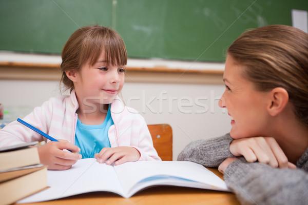 A teacher and a schoolgirl talking in a classroom Stock photo © wavebreak_media