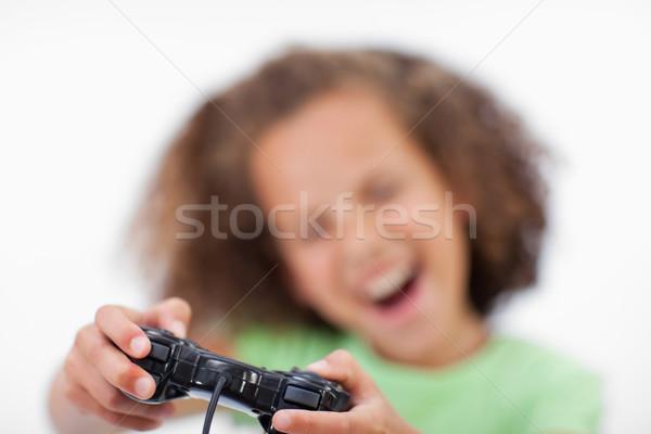 Gülen kız oynama video oyunu beyaz el Stok fotoğraf © wavebreak_media