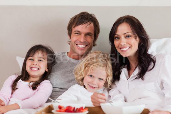 Family having breakfast together in a bedroom Stock photo © wavebreak_media