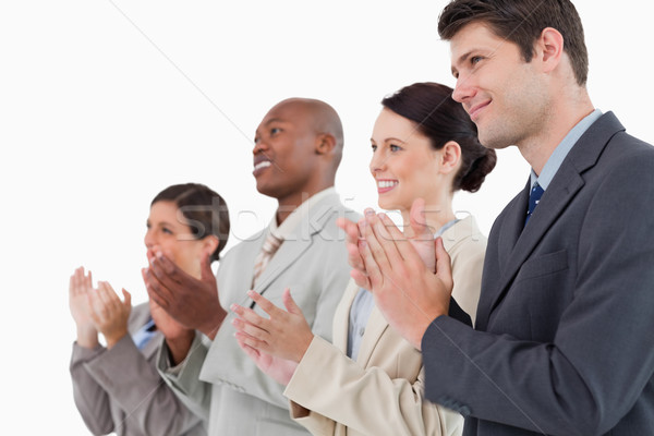 Side view of applauding salesteam standing together against a white background Stock photo © wavebreak_media