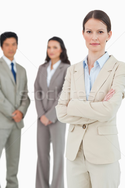 Confident tradeswoman with arms folded and team behind her against a white background Stock photo © wavebreak_media