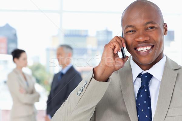 Photo stock: Jeunes · exécutif · rire · téléphone · portable · bureau · sourire