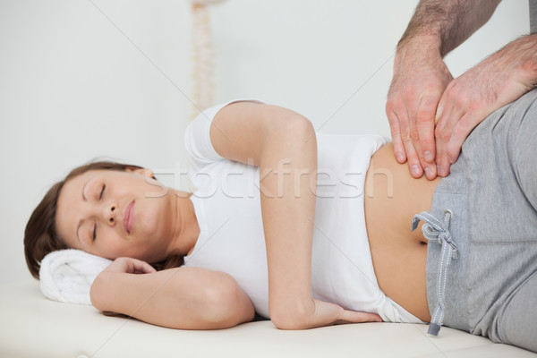 Peaceful woman being massaged by her practitioner in a room Stock photo © wavebreak_media