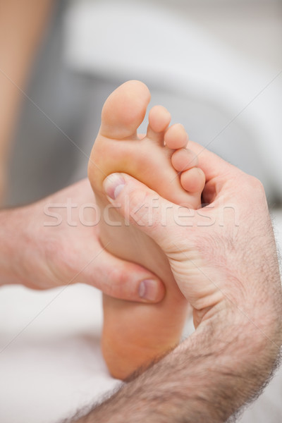 Sole of foot being massaged in a medical room Stock photo © wavebreak_media