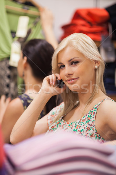 Woman is standing in the boutique while phoning  Stock photo © wavebreak_media