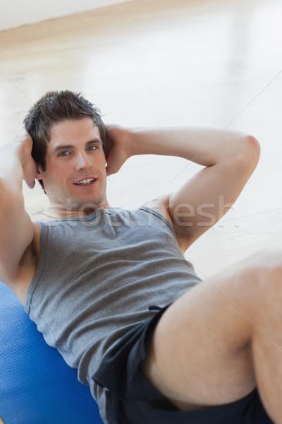 Man doing sit ups at the gym Stock photo © wavebreak_media