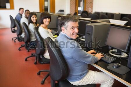Heureux ordinateur classe collège visage travaux Photo stock © wavebreak_media