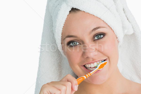 Woman with hair towel washing her teeth in the white background Stock photo © wavebreak_media
