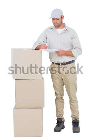 Mature courier man carrying package Stock photo © wavebreak_media
