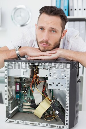 Portrait of confused it professional with chips in front of open Stock photo © wavebreak_media