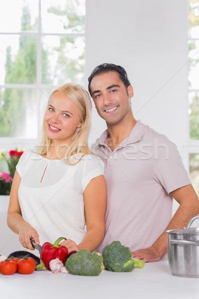 Smiling blonde woman cooking with her husband Stock photo © wavebreak_media