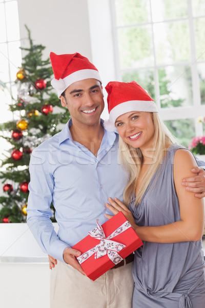 Attractive couple at christmas Stock photo © wavebreak_media