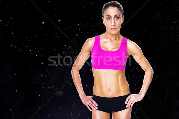 Immagine femminile bodybuilder posa mani Foto d'archivio © wavebreak_media