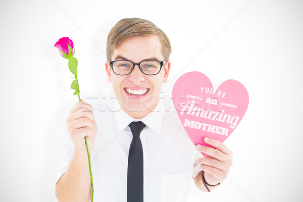 Composite image of geeky hipster holding a red rose and heart ca Stock photo © wavebreak_media