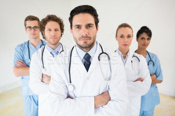 Medical team standing arms crossed Stock photo © wavebreak_media